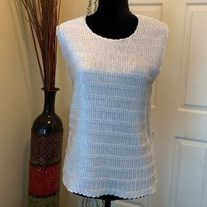 White sleeveless textured blouse, size L